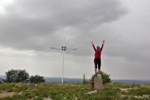 Anne on the summit marker