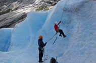 Ready to practice ice-climbing. Anne tests the belays