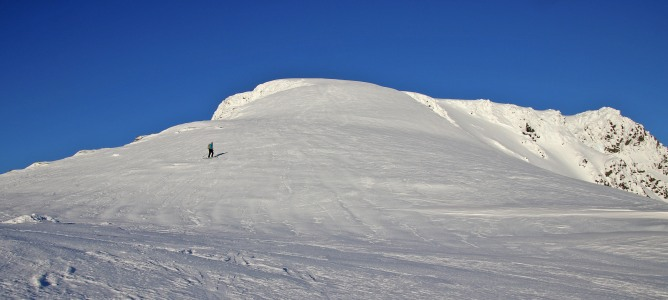 Skiing down the upper hill