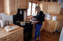 Anne preparing a steak dinner