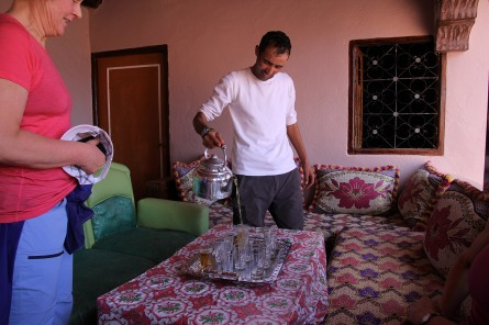 Abdul demonstrates how tea should be served