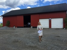 Anne in front of the barn
