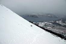 Traversing the steep hillside