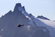 A helicopter and Kolåstinden